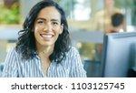portrait shot of a beautiful... | Shutterstock . vector #1103125745