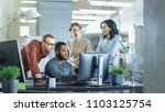in busy corporate office team... | Shutterstock . vector #1103125754