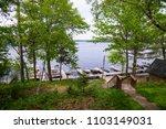 lake dock boats boating trees... | Shutterstock . vector #1103149031