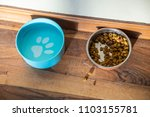 dog food and water bowl messy... | Shutterstock . vector #1103155781