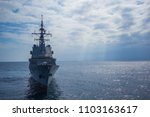 A war ship frigate at sea in a...
