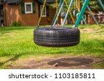 tire swing playground park... | Shutterstock . vector #1103185811