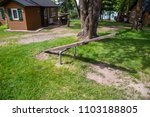 Small photo of Teeter totter playground balance seesaw wood old vintage classic summer camp