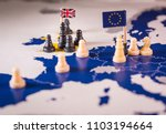 chess pieces and flags on an... | Shutterstock . vector #1103194664
