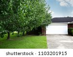1980's brick ranch house in the ... | Shutterstock . vector #1103201915