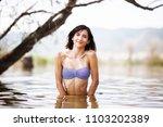 sexy girl posing in water.... | Shutterstock . vector #1103202389