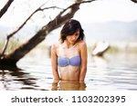 sexy girl posing in water.... | Shutterstock . vector #1103202395