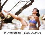 sexy girl posing in water.... | Shutterstock . vector #1103202401