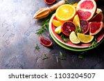 sliced citrus fruit on the... | Shutterstock . vector #1103204507
