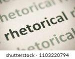 Small photo of word rhetorical printed on white paper macro