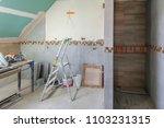 bathroom interior at renovation ... | Shutterstock . vector #1103231315