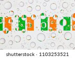 flags  of ireland behind a... | Shutterstock . vector #1103253521