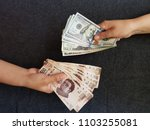 hands on currency exchange ... | Shutterstock . vector #1103255081