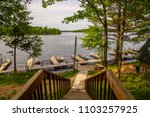 north woods lake dock boats... | Shutterstock . vector #1103257925