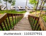 north woods lake dock boats... | Shutterstock . vector #1103257931
