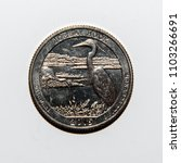 Small photo of A quarter dollar (25 cents) coin with the image of Bombay Hock National Park, Delaware, USA