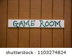 game room sign on wood painted...   Shutterstock . vector #1103274824
