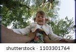pov  lifting a cute little... | Shutterstock . vector #1103301764