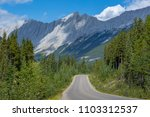 road in rocky mountains | Shutterstock . vector #1103312537
