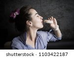 beautiful girl eating a cookie | Shutterstock . vector #1103422187