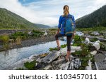woman tourist hiker stands on... | Shutterstock . vector #1103457011