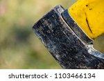 butt of an axe closeup | Shutterstock . vector #1103466134