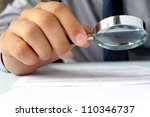 businessman looking through a... | Shutterstock . vector #110346737