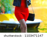 slender legs of a girl in a red ... | Shutterstock . vector #1103471147