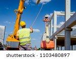 worker is helping crane from...   Shutterstock . vector #1103480897