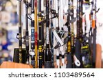 stand with diverse fishing rods ... | Shutterstock . vector #1103489564