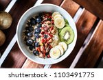 top down view of a muesli bowl... | Shutterstock . vector #1103491775