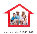 Happy family with kids in their home concept sitting in a house shaped frame - isolated - stock photo