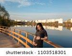 pregnant girl is standing near... | Shutterstock . vector #1103518301