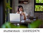 women sit and eat coffee in... | Shutterstock . vector #1103522474
