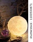 decorative moon lamp and stones ... | Shutterstock . vector #1103533871