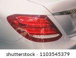 closeup red car taillight | Shutterstock . vector #1103545379