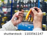 fishing lure baits in the hands ... | Shutterstock . vector #1103561147