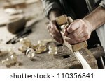hands of a carpenter planed...