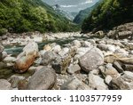 stony bed  teal water   the... | Shutterstock . vector #1103577959