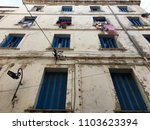 Small photo of Casbah, Algiers, Algeria - December 17, 2016: Algerian houses with blue windows and drying clothes.