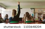 rear view of female student... | Shutterstock . vector #1103648204