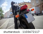 woman with a black helmet on a... | Shutterstock . vector #1103672117