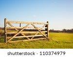 An Open Gate On Farmland In...
