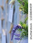 Small photo of Lavender wedding arrangement on a wood table . (closeup)