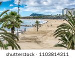 the beach of barcelona with... | Shutterstock . vector #1103814311