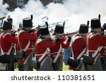 "FORT GEORGE, SCOTLAND- AUGUST 11 : Redcoat soldiers firing rifles during the annual ""Celebration of the Centuries"" event at Fort George, Scotland, August 11, 2012 - stock photo"