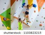 rock climbers in climbing gym....   Shutterstock . vector #1103823215