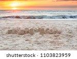 a fiery sunrise over the... | Shutterstock . vector #1103823959