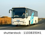 Khanty-Mansiysk, Russia - October 6, 2016: White coach bus Irisbus Crossway 12M at the interurban road. - stock photo