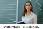 teacher with book dictates in... | Shutterstock . vector #1103836307